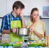 Housewife put too much spices in food Stock Photo