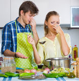 Housewife put too much spices in food Stock Images