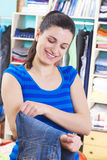 Housewife putting clothes on available space Stock Photography
