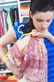 Housewife putting clothes on available space Royalty Free Stock Photos