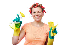 Housewife with rag wipe and cleaning spray Royalty Free Stock Photos