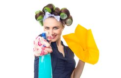 Housewife with rag. Woman with rag or wipe and cleaning spray for window. Close up of  housewife, isolated on white Royalty Free Stock Photo