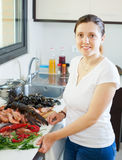 Housewife with raw seafood Stock Image