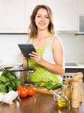 Housewife reading recipes Royalty Free Stock Images