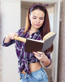 Housewife reads cookbook Stock Images
