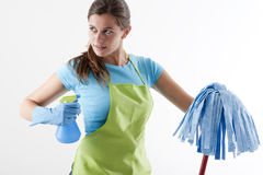 Housewife Ready To Fight With Spray Bottle and Mop Stock Images