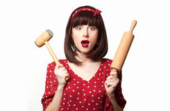 Housewife red dress with rolling pin and hummer Stock Photo