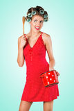 Housewife in red standing and cooking Royalty Free Stock Photo