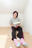 Housewife resting after painting wall to white Stock Photography