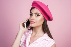 Housewife. retro woman with moneybox. pin up woman with trendy makeup. girl in vintage style. pinup girl with fashion. Hair. i will connect you in one second royalty free stock photos