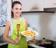 Housewife roasting breadcrumbed kroketten Royalty Free Stock Photo