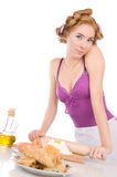 Housewife with rollers baking Stock Photography