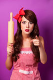 Housewife with rolling pin Royalty Free Stock Image