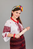Housewife with rolling pin. Woman wears Ukrainian national dress Stock Photo