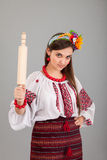 Housewife with rolling pin. Woman wears Ukrainian national dress Stock Photos