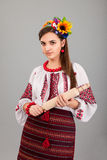 Housewife with rolling pin. Woman wears Ukrainian national dress Royalty Free Stock Photography