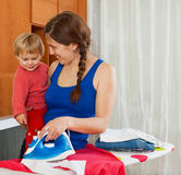 Housewife in the room ironing clothes iron Royalty Free Stock Photo