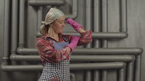 Housewife in rubber gloves showing muscular strength stock video