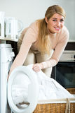 Housewife satisfied with quality of washing Royalty Free Stock Photo