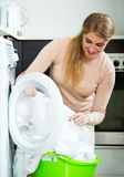 Housewife satisfied with quality of washing Royalty Free Stock Images