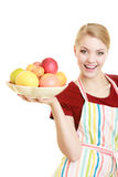 Housewife or seller offering healthy fruit isolated Stock Photography