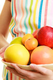 Housewife or seller offering healthy fruits isolated Stock Photos