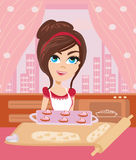 Housewife serving cookies Stock Image