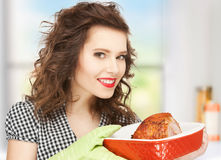 Housewife serving dish with meat Stock Photography