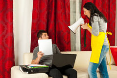 Housewife shouting to her husband Royalty Free Stock Photography