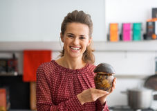 Housewife showing jar of pickled mushrooms Royalty Free Stock Photography