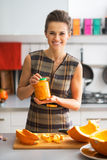 Housewife showing jar of pickled pumpkin Royalty Free Stock Photos