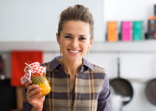 Housewife showing jar with pickled vegetables Royalty Free Stock Photos