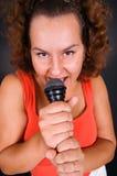 Housewife singing at karaoke royalty free stock image
