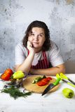 Housewife sits at the table and thinks. royalty free stock images