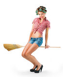 Housewife sitting on a broom Stock Photo