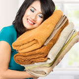 Housewife smell fresh laundry. Woman doing a housework holding laundry. smell good Stock Image