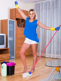Housewife smiling and doing floor cleaning indoors Royalty Free Stock Photos