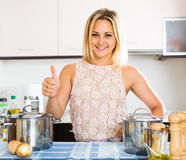 Housewife smiling at new kitchen Stock Photography