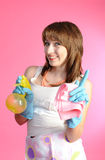 Housewife smiling on pink background Royalty Free Stock Photography
