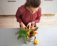 Housewife sort purchases after shopping. Young housewife sort purchases after shopping on local market Stock Photo