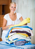 Housewife with stack of linen Stock Image