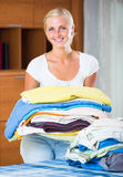 Housewife with stack of linen stock photos