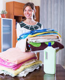 Housewife with stack of linen Royalty Free Stock Photography