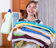 Housewife with stack of linen Stock Images