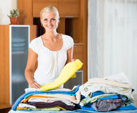 Housewife with stack of linen Royalty Free Stock Photo