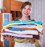 Housewife with stack of linen Royalty Free Stock Photos