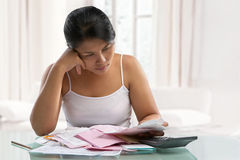 Housewife stress over bills and debts Royalty Free Stock Photo