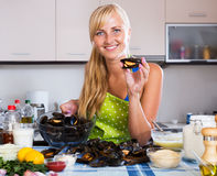 Housewife stuffing mollusc shells Royalty Free Stock Photo