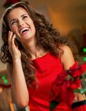 Housewife talking phone in christmas decorated kitch Royalty Free Stock Photos