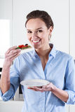 Housewife tastes healthy snack Stock Images